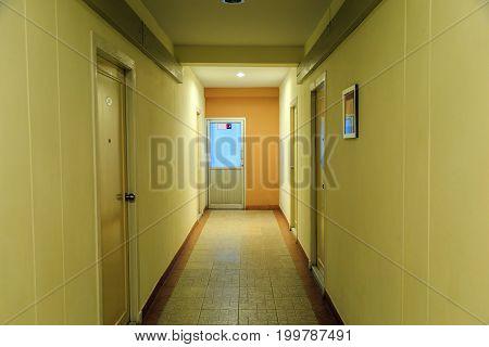 Hotel corridorh to the fire exit door in the hotel.