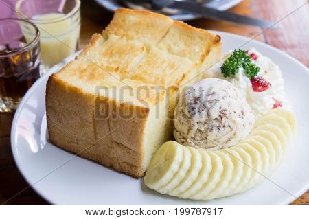 Toast and ice cream and banana dessert in cafe