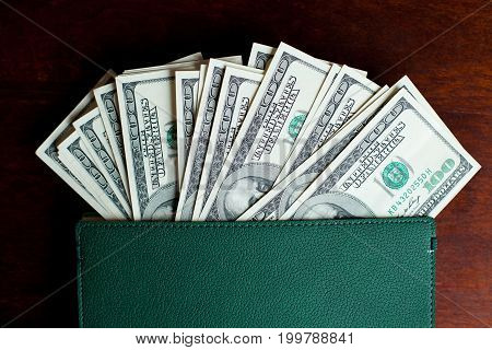 Stacks Of One Hundred Dollars Banknotes In Notebook