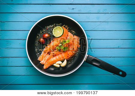 Salmon Fillets Seasoned And Ready To Cook On A Wooden Table