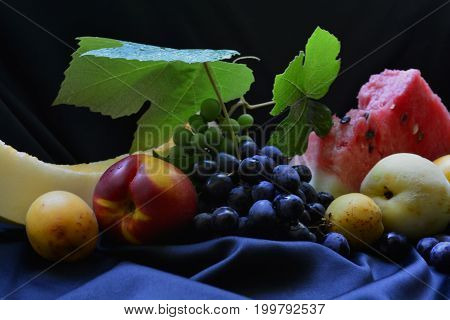 richness of the harvest of fruits and berries on a festive table