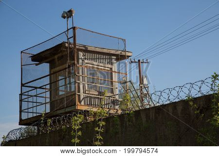 Watchtower criminal zone barbed fence jail nobody
