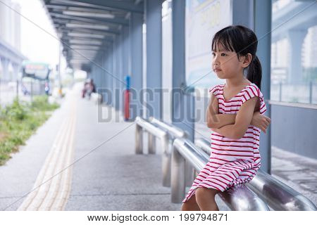 Asian Chinese Little Girl Waiting For A Bus