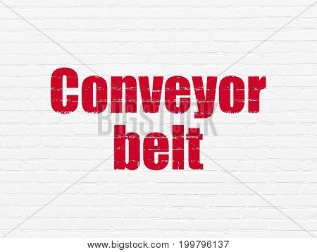 Manufacuring concept: Painted red text Conveyor Belt on White Brick wall background