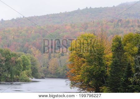 Stretch of Connecticut River near Mount Orne Bridge on rainy morning
