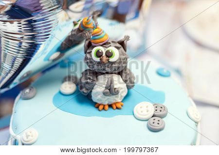 Cake for first birthday, number one and owl figure made of sugar on top
