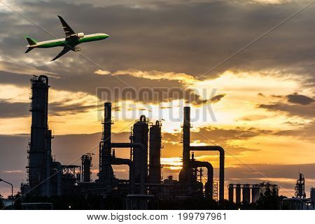 Airplane in the sky over Oil Refinery factory industry with blue sky and clouds. Petrochemical plant Petroleum Industrial-plant.