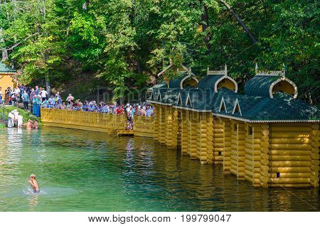 TSYGANOVKA RUSSIA - AUGUST 22 2015: Unknown pilgrims are on holy spring in name of Monk Seraphim of Sarov near village of Tsyganovka Russia