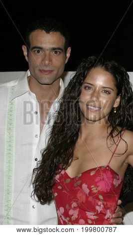 Luis Roberto Guzman and Ana Claudia Talancon at the 8th Los Angeles Latino International Film Festival held at the Egyptian Theater in Hollywood, USA on July 16, 2004.