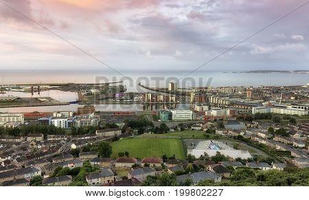 Editorial SWANSEA, UK - JUNE 4, 2017: Swansea city east shot from Kilvey Hill, showing the docks, the St. Thomas area and the marina with Mumbles in the far distance.