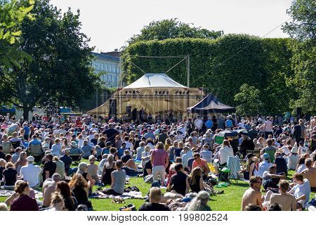 Copenhagen, Denmark - July 09, 2017: A band performing on a stage in front of a crowd for the Jazz Festival in King's Garden.