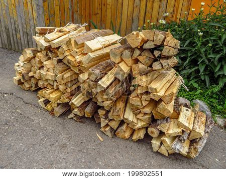 Bundles of chopped firewood in the countryside