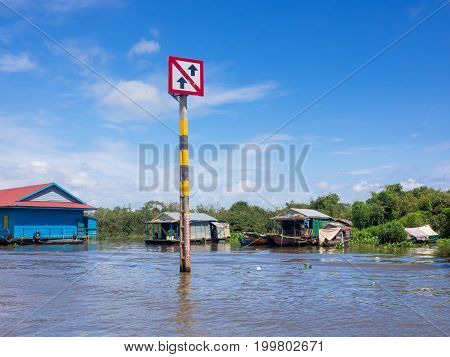 Boat traffic sign at Tonle Sap Lake, Siem Reap, Cambodia, caution about the traffic in community district.