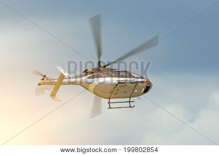 Helicopter Turns Flying In The Sky On A Cloudy Day