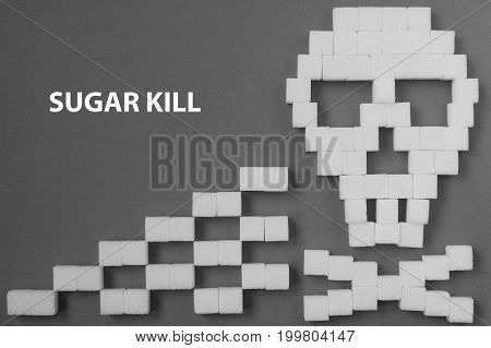 The skull made from sugar cubes. Sugar Kills. grey background. diabetes concept. Suggesting dieting concept. Unhealthy white sugar concept. Copy space. Space for text.