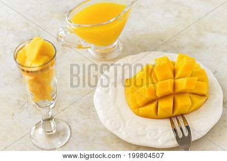 Mango Fruit Cubes And Mango Juice Puree On White Concrete Background. Tropical Fruit Concept. Vegan