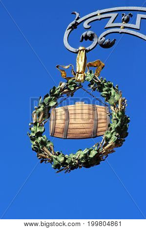 beautiful old inn sign showing a beer barrel with a wreath of hop and barley ears