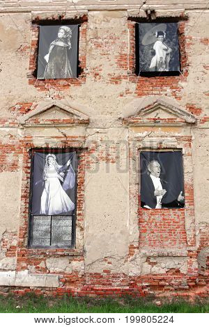TULCHYN UKRAINE - JUNE 05 2017: Tulchyn castle is decorated with photographies of famous people in opera world during OperaFestTulchyn international opera open air festival that was held in Tulchyn on the territory of Potocki Palace, Vinnytsia regio,n Ukr
