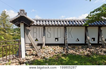 SHIRAKAWA JAPAN - JUNE 2 2017: Reconstructed earthen walls of Shirakawa (Komine) Castle Japan. Castle was founded in 1340 rebuilt in 1627 destroyed in war of 1868 and reconstructed in 1991