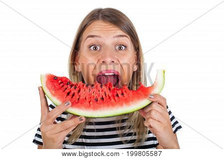 Picture of a hungry young woman eating a big slice of delicious watermelon on isolated background