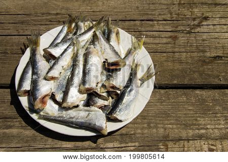 Gutted Baltic Herring On A Plate On Rustic Wooden Table