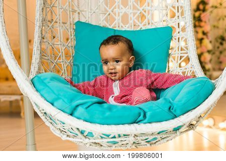Portrait of mixed race kid at home.