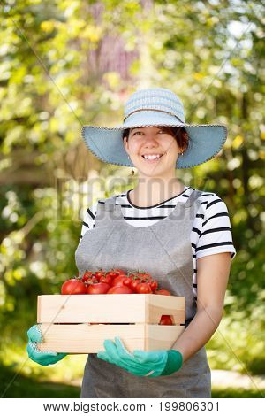 Photo of woman with tomato