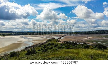 Looking across the causeway from Cramond Island to Cramond on the outskirts of Edinburgh Scotland at low tide