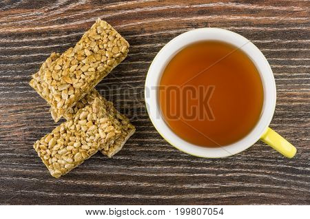 Cup Of Tea, Broken Kozinaki With Sunflower Seeds  On Table