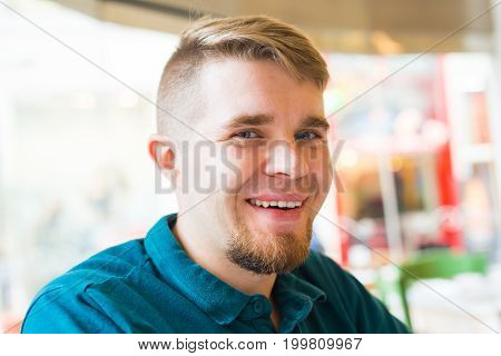 Portrait of a handsome blond man looking to camera.