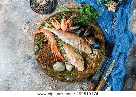 Photo on top of fresh seafood on plate with rosemary