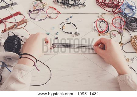 Handmade jewelry making, female hobby. Woman creating bracelet at home workshop, artisan pov. Fashion, handicraft concept