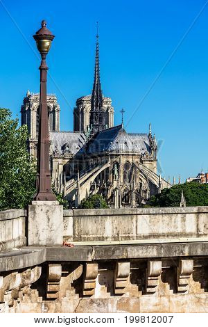 View of southern facade of Notre Dame de Paris Cathedral on the Cite Island. Notre Dame Cathedral is a medieval catholic cathedral and finest example of french gothic architecture. Paris France.