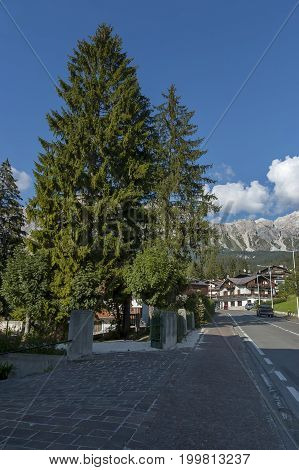 Autumnal corso Italia, the residential district in the town Cortina d'Ampezzo with mountain, Dolomite, Alps, Veneto, Italy, Europe
