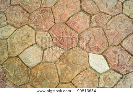 Brown and beige cobbles different sizes background texture