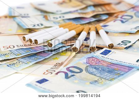 20 and 50 Euro banknotes bills cash with cigarettes with cigarettes box. Concept of cost of tabacco cigarettes.
