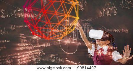 Digital image of geometric shape against schoolgirl using virtual reality headset against blackboard