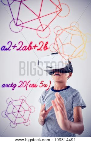 Geometric shapes against white background against schoolboy using virtual reality headset