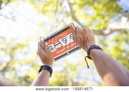 Online banking and payment declined text on phone screen against cropped hands using digital tablet