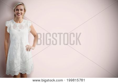 Portrait of smiling blonde woman against white background  against neutral background