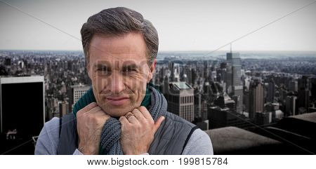 Portrait of handsome mature man  against high angle view of city skyline