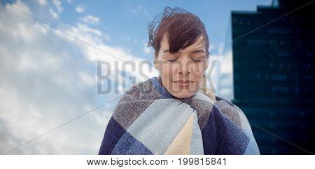 Portrait of brunette women wearing scarf against cloudscape in sky by glass building