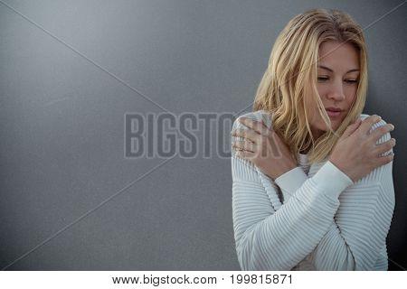 Portrait of beautiful blonde women  against grey background