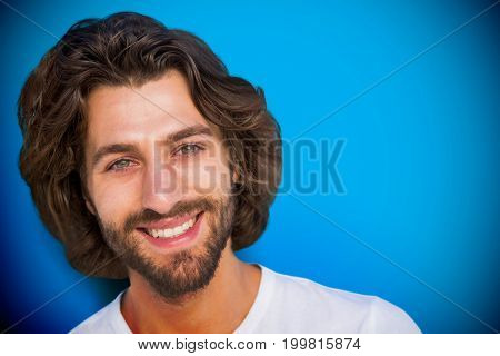 Profile portrait serious brunette man  against blue background with vignette