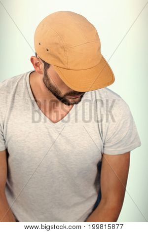 Portrait of handsome man wearing hat against blue background