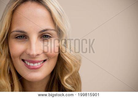 Portrait of beautiful blonde women  against beige background