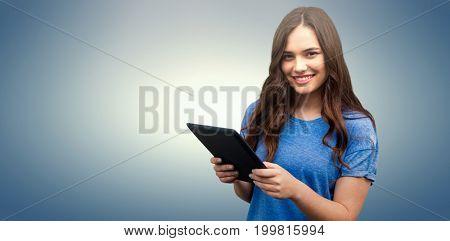 Brunette women holding tablet  against purple vignette