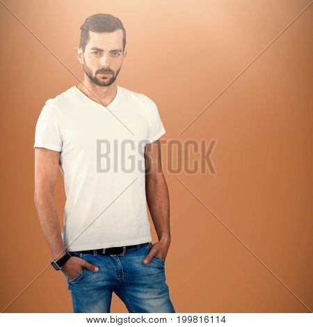 Confident and handsome man posing  against brown background