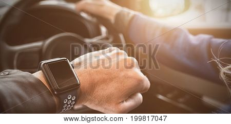 Cropped image of woman wearing wristwatch in car during test drive
