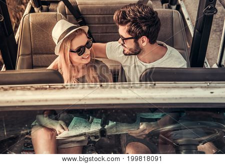 Couple Travelling By Car
